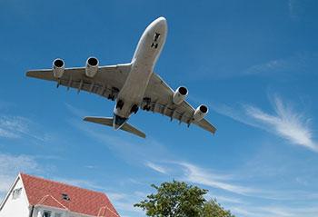 passenger-jet-over-house